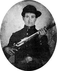 Black and white photo of Hezekiah Blevens in uniform as a Private in Comapny C, 80th Indiana Volunteer Infantry Regiment, circa 1862, enhanced image.