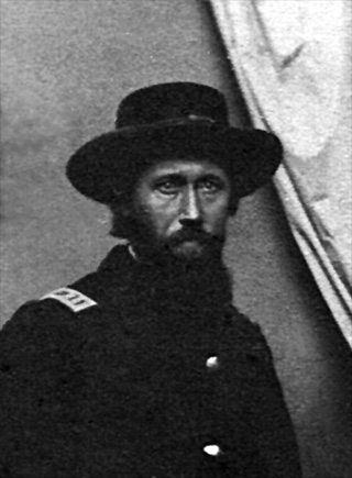 Black and white post-war photo of Captain Isum Gwin of Company D, 80th Indiana Volunteer Infantry, in uniform, enhanced image.
