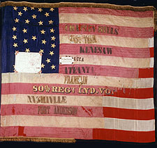 Color photograph of the 80th Indiana's National flag with battle honors: Chaplin HIlls, East. Tenn., Kenesaw, Resaca, Atlanta, Franklin, Nashville, and Fort Anderson